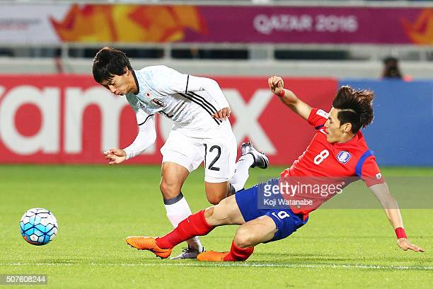 Sei Muroya of Japan and Lee Changmin of Korea compete for the ball during the AFC U23 Championship final match between South Korea and Japan at the...