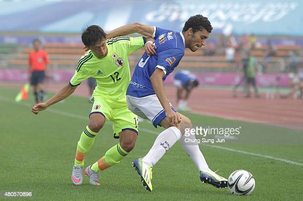 Sei Muroya of Japan compete for the ball with Eriveltro Monteiro Da Silva during the Men's Football third place match between Japan and Brazil during...