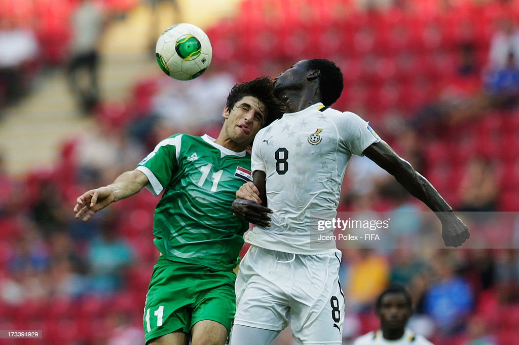 Seidu Salifu (R) of Ghana and Humam Tareq of Iraq compete for the ball during the FIFA U-20 World Cup 3rd Place playoff match between Ghana and Iraq at Ali Sami Yen Arena on July 13, 2013 in Istanbul, Turkey.