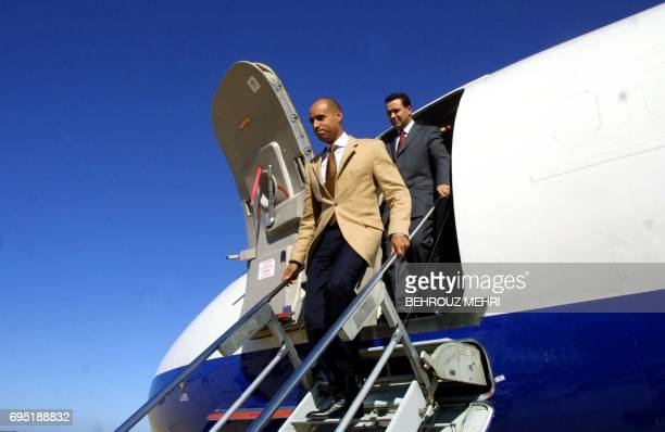 Seif ElIslam son of Libyan leader Moamer Kadhafi arrives in the northern coastal city of Syrte 02 March 2002 aboard a French airliner to attend a...