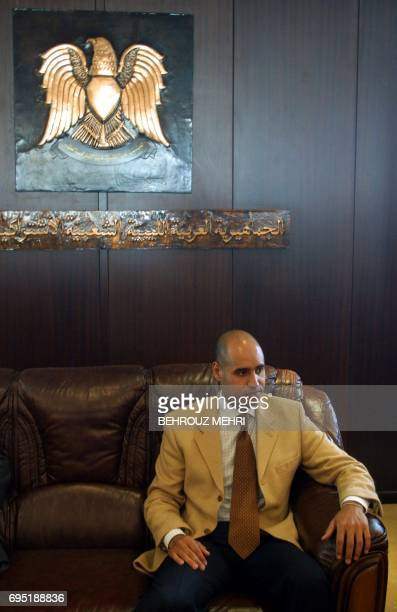 Seif ElIslam son of Libyan leader Moamer Kadhafi arrives in the northern coastal city of Syrte 02 March 2002 to attend a massive rally marking the...