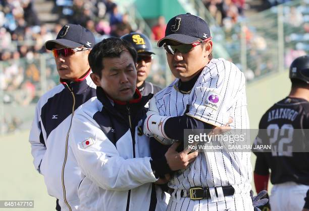 Seiichi Uchikawa of Samurai Japan walks out of the field after injuring his elbow in the eighth inning during the SAMURAI JAPAN Friendly Opening...