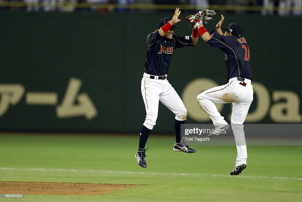 Seiichi Uchikawa and Yoshio Itoi of Team Japan celebrate defeating Team Chinese Taipei in extra innings in Pool 1 Game 2 in the second round of the...