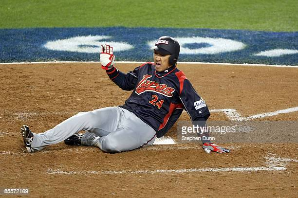Seiichi Uchikawa of Japan scores on a sacrifice fly by Akinori Iwamura in the eighth inning of the finals of the 2009 World Baseball Classic against...