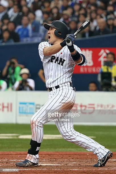 Seiichi Uchikawa of Samurai Japan bats in the seventh inning during the Game one of Samurai Japan and MLB All Stars at Kyocera Dome Osaka on November...