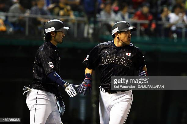 Seiichi Uchikawa of Samurai Japan celerates after scoring in the top half of the second inning during the exhibition game between Samurai Japan and...
