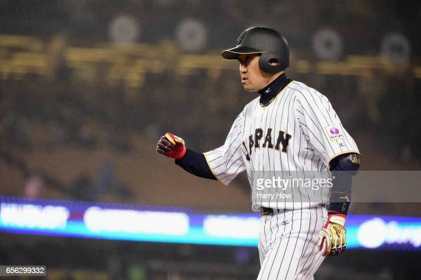 Seiichi Uchikawa of team Japan celebrates his single in the eighth inning against team United States during Game 2 of the Championship Round of the...