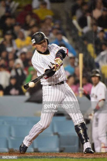 Seiichi Uchikawa of team Japan hits a single in the eighth inning against team United States during Game 2 of the Championship Round of the 2017...