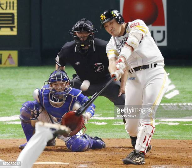 Seiichi Uchikawa of the SoftBank Hawks hits a gametying solo home run in the ninth inning in Game 6 of the Japan Series against the DeNA BayStars at...