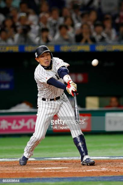 Seiichi Uchikawai of Team Japan hits a gamewinning sacrifice fly in the eighth inning during Game 4 of Pool E of the 2017 World Baseball Classic...