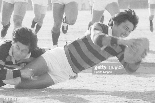 Seiji Hirao of Doshisha University runs with the ball during the All Japan College Rugby Championship final match between Doshisha University and...