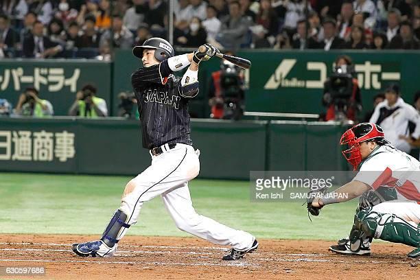 Seiji Kobayashi of Japan bats during the international friendly match between Mexico and Japan at the Tokyo Dome on November 11 2016 in Tokyo Japan