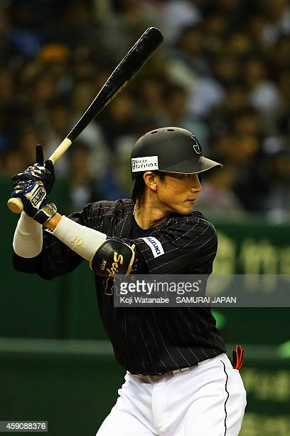 Seiji Kobayashi of Samurai Japan bats during the game four of Samurai Japan and MLB All Stars at Tokyo Dome on November 16 2014 in Tokyo Japan
