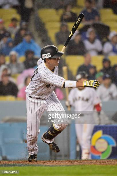 Seiji Kobayashi of team Japan singles in the third inning against team United States during Game 2 of the Championship Round of the 2017 World...