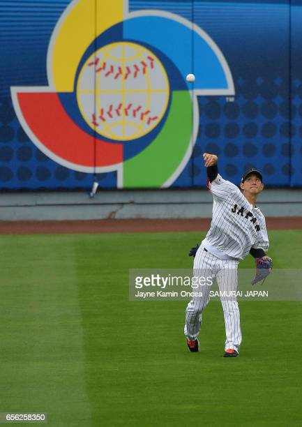Seiji Kobayashi of the Japan throws a ball during warm ups before playing against the United States during Game 2 of the Championship Round of the...