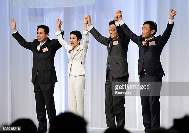 Seiji Maehara a candidate for president of the Democratic Party of Japan and former foreign minister from left Renho Murata presidentelect of the DPJ...