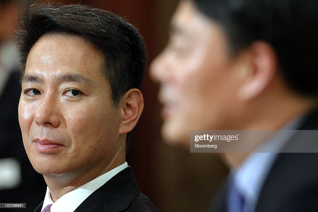 Seiji Maehara Japan's former foreign minister left looks on as Banri Kaieda economy trade and industry minister speaks during a joint news conference...