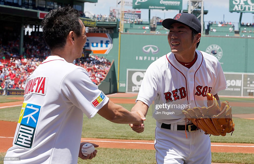Seiji Miyane of Yomiuri Television, Japan, shakes hands with Koji Uehara #19 of the Boston Red Sox after throwing out the first pitch before a game between the Minnesota Twins and the Boston Red Sox at Fenway Park on June 18, 2014 in Boston, Massachusetts.
