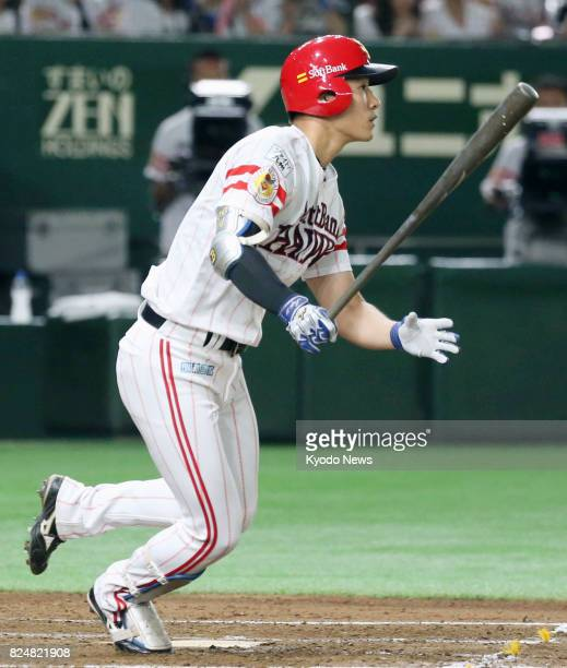 Seiji Uebayashi of the SoftBank Hawks hits a threerun homer in the thirdinning of a game against the Nippon Ham Fighters at Tokyo Dome on July 31...