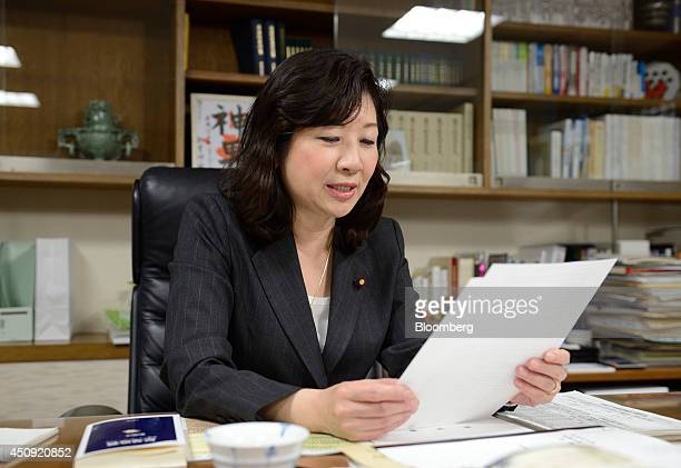 Seiko Noda chairperson for the general council of the Liberal Democratic Party looks at a document after an interview in Tokyo Japan on Wednesday...