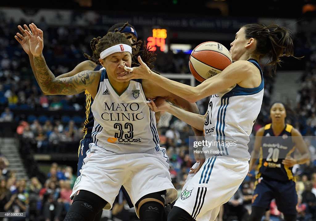 Seimone Augustus and Anna Cruz of the Minnesota Lynx go after a loose ball during the fourth quarter in Game Two of the 2015 WNBA Finals against the...