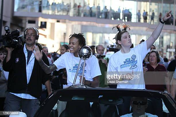 Seimone Augustus and Lindsay Whalen of the 2011 WNBA Champions Minnesota Lynx wave to the crowd during the Minnesota Lynx Championship Parade through...