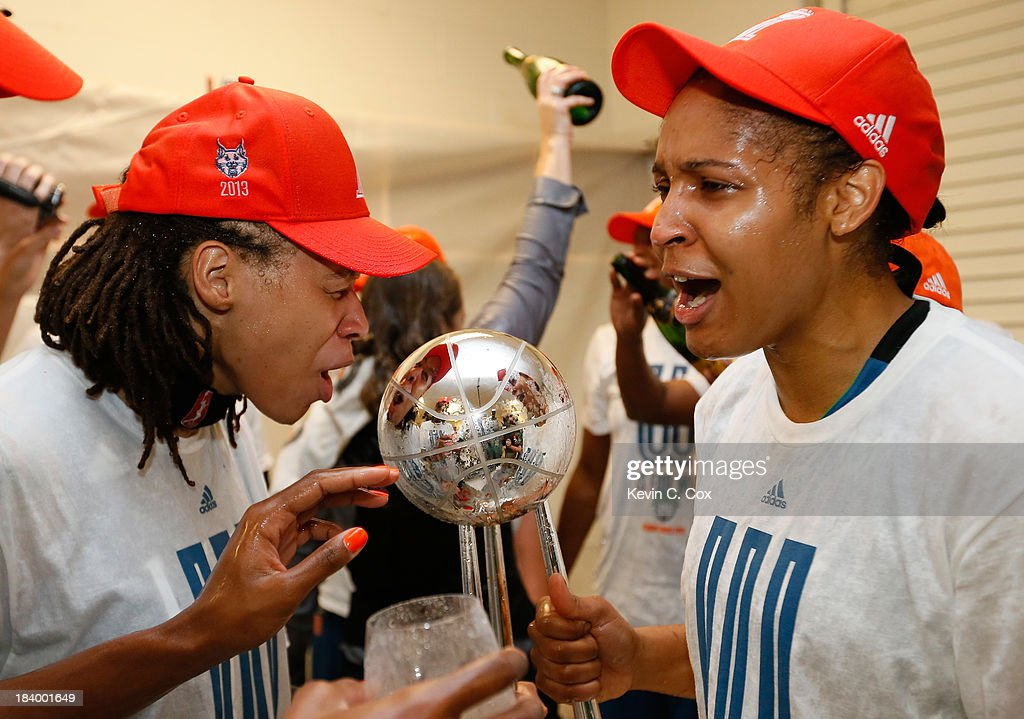 Seimone Augustus and Maya Moore of the Minnesota Lynx celebrate with the trophy after their 8677 win over the Atlanta Dream in Game Three of the 2013...