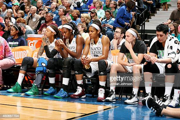 Seimone Augustus Asia Taylor Maya Moore Lindsey Moore and Janel McCarville of the Minnesota Lynx sit on the sideline during a game against the...