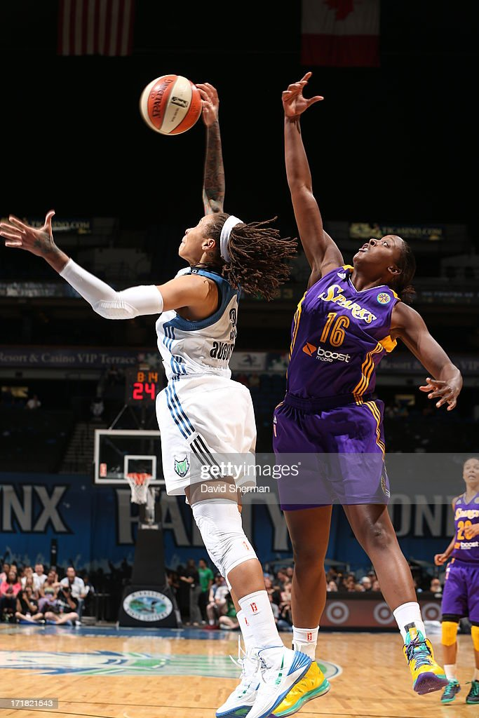 <a gi-track='captionPersonalityLinkClicked' href=/galleries/search?phrase=Seimone+Augustus&family=editorial&specificpeople=540457 ng-click='$event.stopPropagation()'>Seimone Augustus</a> #33 gets the rebound against <a gi-track='captionPersonalityLinkClicked' href=/galleries/search?phrase=Lindsey+Harding&family=editorial&specificpeople=704302 ng-click='$event.stopPropagation()'>Lindsey Harding</a> #16 of the the Los Angeles Sparks during the WNBA game on June 28, 2013 at Target Center in Minneapolis, Minnesota.