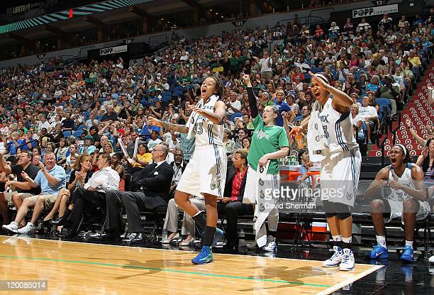 Seimone Augustus Lindsay Whalen Maya Moore and Rebekkah Brunson of the Minnesota Lynx celebrate after the game against the Seattle Storm on July 29...