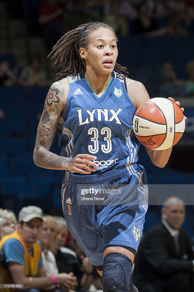 Seimone Augustus #33 of the Minnesota Lynx brings the ball up court against the Tulsa Shock during the WNBA game on June 14, 2013 at the BOK Center in Tulsa, Oklahoma.