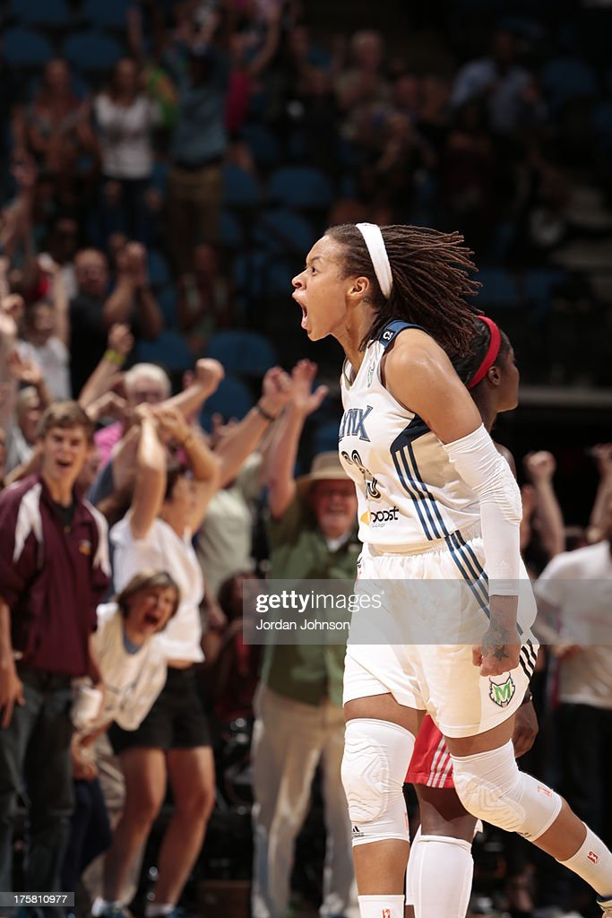 <a gi-track='captionPersonalityLinkClicked' href=/galleries/search?phrase=Seimone+Augustus&family=editorial&specificpeople=540457 ng-click='$event.stopPropagation()'>Seimone Augustus</a> #33 of the Minnesota Lynx celebrates after scoring a 3-pointer to tie the game late in the 4th Quarter against the Washington Mystics during the WNBA game on August 8, 2013 at Target Center in Minneapolis, Minnesota.