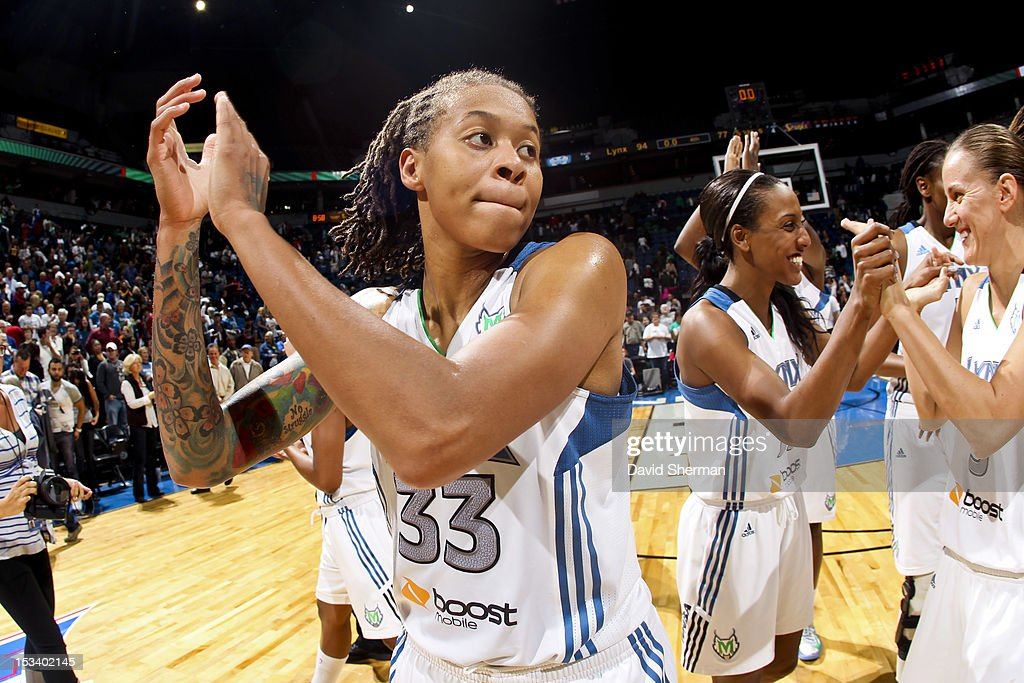 <a gi-track='captionPersonalityLinkClicked' href=/galleries/search?phrase=Seimone+Augustus&family=editorial&specificpeople=540457 ng-click='$event.stopPropagation()'>Seimone Augustus</a> #33 of the Minnesota Lynx celebrates her team's victory against the Los Angeles Sparks after Game One of the 2012 WNBA Western Conference Finals on October 4, 2012 at Target Center in Minneapolis, Minnesota.