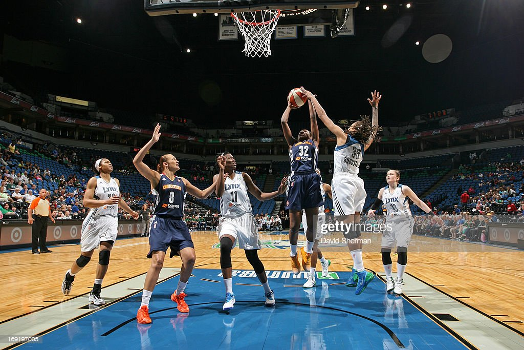 <a gi-track='captionPersonalityLinkClicked' href=/galleries/search?phrase=Seimone+Augustus&family=editorial&specificpeople=540457 ng-click='$event.stopPropagation()'>Seimone Augustus</a> #33 of the Minnesota Lynx defends a shot against Kalana Greene #32 of the Connecticut Sun during the WNBA pre-season game on May 21, 2013 at Target Center in Minneapolis, Minnesota.