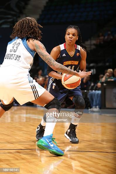 Seimone Augustus of the Minnesota Lynx defends against Tan White of the Connecticut Sun during the WNBA preseason game on May 21 2013 at Target...