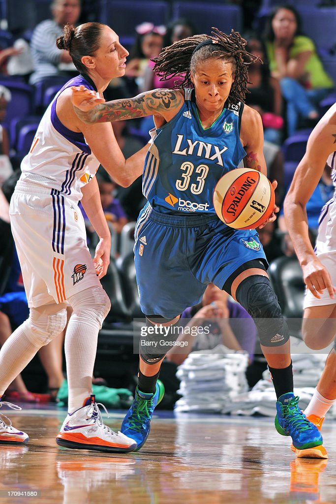 <a gi-track='captionPersonalityLinkClicked' href=/galleries/search?phrase=Seimone+Augustus&family=editorial&specificpeople=540457 ng-click='$event.stopPropagation()'>Seimone Augustus</a> #33 of the Minnesota Lynx dribbles the ball against the Phoenix Mercury on June 19, 2013 at U.S. Airways Center in Phoenix, Arizona.
