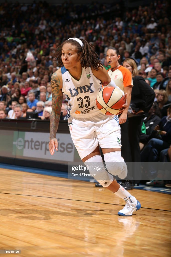 <a gi-track='captionPersonalityLinkClicked' href=/galleries/search?phrase=Seimone+Augustus&family=editorial&specificpeople=540457 ng-click='$event.stopPropagation()'>Seimone Augustus</a> #33 of the Minnesota Lynx drives to the basket against the Chicago Sky during the WNBA game on September 14, 2013 at Target Center in Minneapolis, Minnesota.