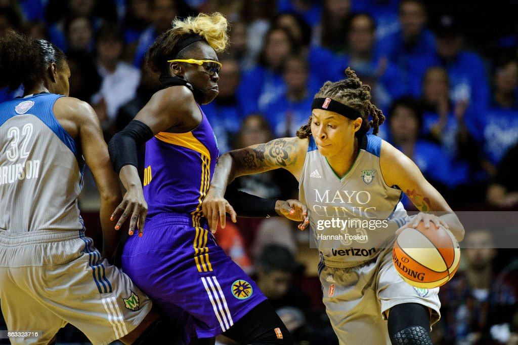 Seimone Augustus #33 of the Minnesota Lynx drives to the basket against Essence Carson #17 of the Los Angeles Sparks during the third quarter of Game Two of the WNBA Finals on September 26, 2017 at Williams in Minneapolis, Minnesota. The Lynx defeated the Sparks 70-68.