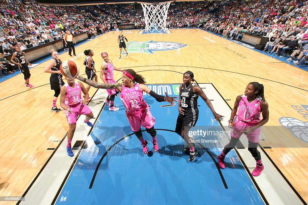 <a gi-track='captionPersonalityLinkClicked' href=/galleries/search?phrase=Seimone+Augustus&family=editorial&specificpeople=540457 ng-click='$event.stopPropagation()'>Seimone Augustus</a> #33 of the Minnesota Lynx gets the rebound against the San Antonio Stars during the WNBA game on July 25, 2014 at Target Center in Minneapolis, Minnesota.