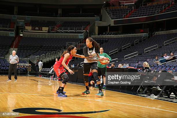 Seimone Augustus of the Minnesota Lynx handles the ball against Bria Hartley of the Washington Mystics during an Analytic Scrimmage at the Verizon...