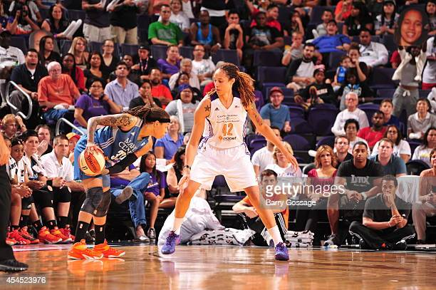 Seimone Augustus of the Minnesota Lynx handles the ball against Brittney Griner of the Phoenix Mercury in Game 3 of the 2014 WNBA Western Conference...