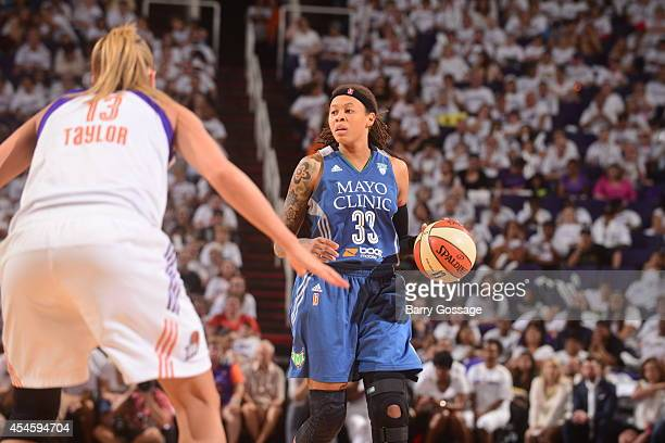 Seimone Augustus of the Minnesota Lynx handles the ball against Penny Taylor of the Phoenix Mercury in Game 1 of the 2014 WNBA Western Conference...