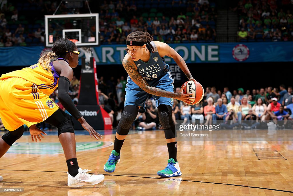 <a gi-track='captionPersonalityLinkClicked' href=/galleries/search?phrase=Seimone+Augustus&family=editorial&specificpeople=540457 ng-click='$event.stopPropagation()'>Seimone Augustus</a> #33 of the Minnesota Lynx handles the ball during the game against <a gi-track='captionPersonalityLinkClicked' href=/galleries/search?phrase=Essence+Carson&family=editorial&specificpeople=2351517 ng-click='$event.stopPropagation()'>Essence Carson</a> #17 of the Los Angeles Sparks during the WNBA game on June 24, 2016 at Target Center in Minneapolis, Minnesota.
