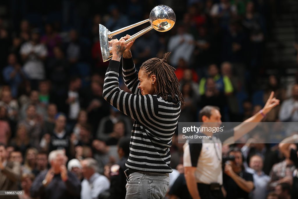 <a gi-track='captionPersonalityLinkClicked' href=/galleries/search?phrase=Seimone+Augustus&family=editorial&specificpeople=540457 ng-click='$event.stopPropagation()'>Seimone Augustus</a> of the Minnesota Lynx holds up the WNBA Championship trophy during the Minnesota Timberwolves against the Oklahoma City Thunder on November 1, 2013 at Target Center in Minneapolis, Minnesota.
