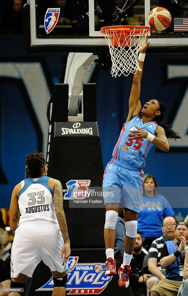 <a gi-track='captionPersonalityLinkClicked' href=/galleries/search?phrase=Seimone+Augustus&family=editorial&specificpeople=540457 ng-click='$event.stopPropagation()'>Seimone Augustus</a> #33 of the Minnesota Lynx looks on as <a gi-track='captionPersonalityLinkClicked' href=/galleries/search?phrase=Angel+McCoughtry&family=editorial&specificpeople=4423621 ng-click='$event.stopPropagation()'>Angel McCoughtry</a> #35 of the Atlanta Dream shoots in the second quarter in Game One of the 2011 WNBA Finals on October 2, 2011 at Target Center in Minneapolis, Minnesota.