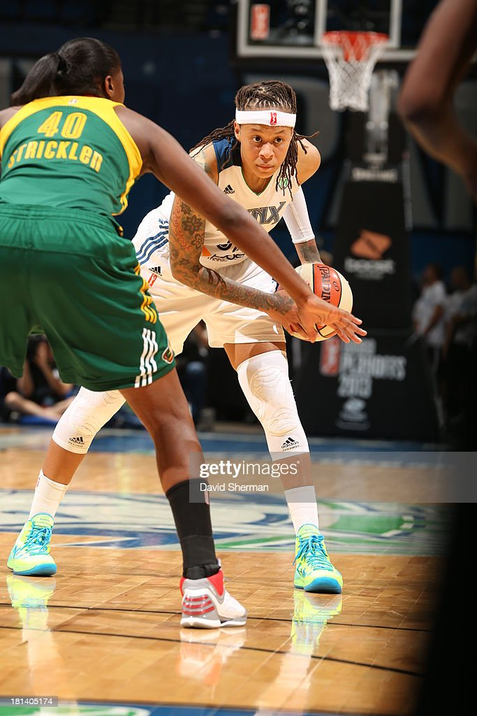 Seimone Augustus #33 of the Minnesota Lynx looks to make a play against Shekinna Stricklen #40 of the Seattle Storm during the WNBA Western Conference Semifinals Game 1 on September 20, 2013 at Target Center in Minneapolis, Minnesota.