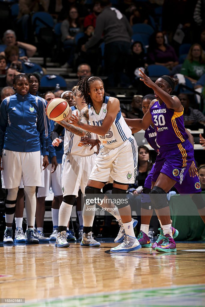 Seimone Augustus #33 of the Minnesota Lynx looks to pass the ball against Nneka Ogwumike #30 of the Los Angeles Sparks during Game One of the 2012 WNBA Western Conference Finals on October 4, 2012 at Target Center in Minneapolis, Minnesota.