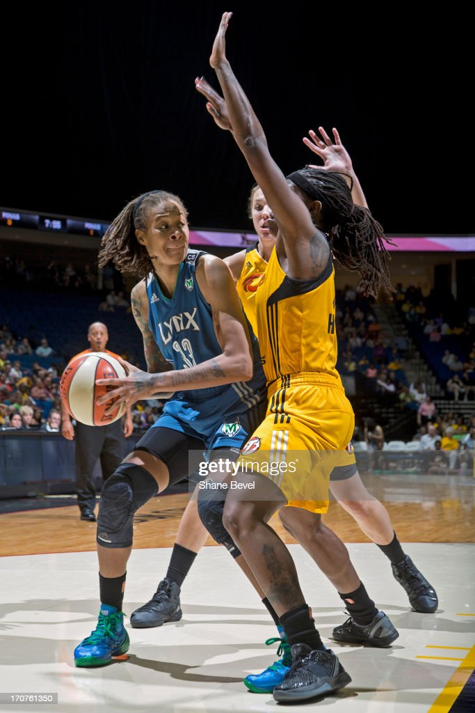 <a gi-track='captionPersonalityLinkClicked' href=/galleries/search?phrase=Seimone+Augustus&family=editorial&specificpeople=540457 ng-click='$event.stopPropagation()'>Seimone Augustus</a> #33 of the Minnesota Lynx looks to pass the ball against the Tulsa Shock during the WNBA game on June 14, 2013 at the BOK Center in Tulsa, Oklahoma.
