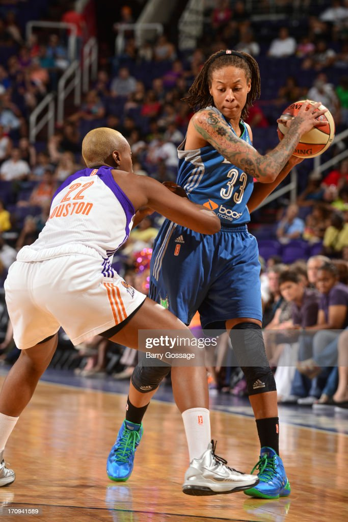 <a gi-track='captionPersonalityLinkClicked' href=/galleries/search?phrase=Seimone+Augustus&family=editorial&specificpeople=540457 ng-click='$event.stopPropagation()'>Seimone Augustus</a> #33 of the Minnesota Lynx looks to pass the ball against the Phoenix Mercury on June 19, 2013 at U.S. Airways Center in Phoenix, Arizona.
