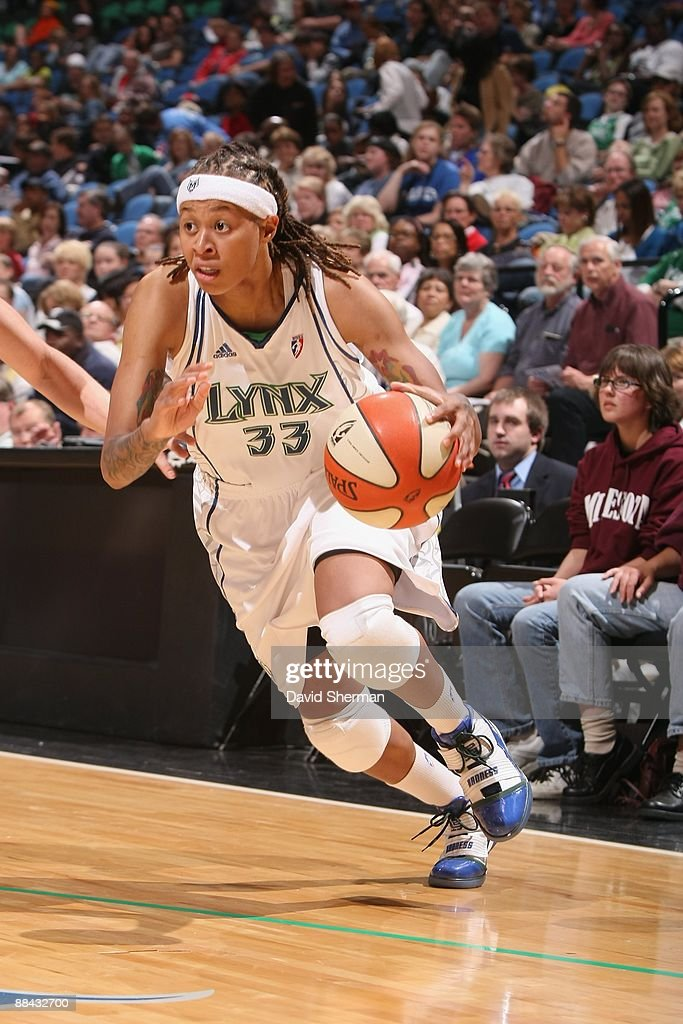 Seimone Augustus of the Minnesota Lynx moves the ball against the Chicago Sky during the game on June 6 2009 at the Target Center in Minneapolis...